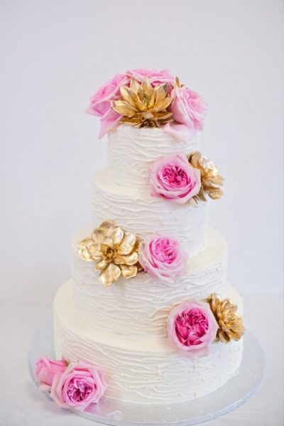 White Fondant Wedding Cake with White Chocolate Lines and Fresh Florals