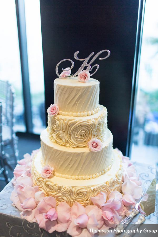 Buttercream rosette with pink roses