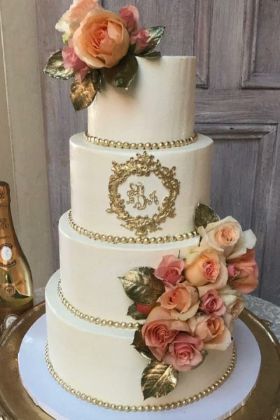 white buttercream cake with gold and pearls