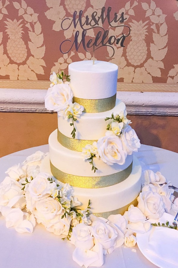 white and gold with white roses