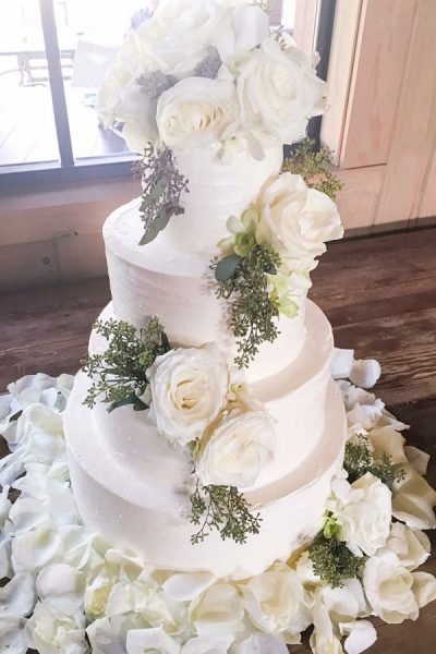 white buttercream cake with white roses