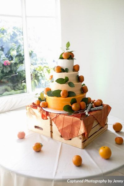 Orange themed wedding cake