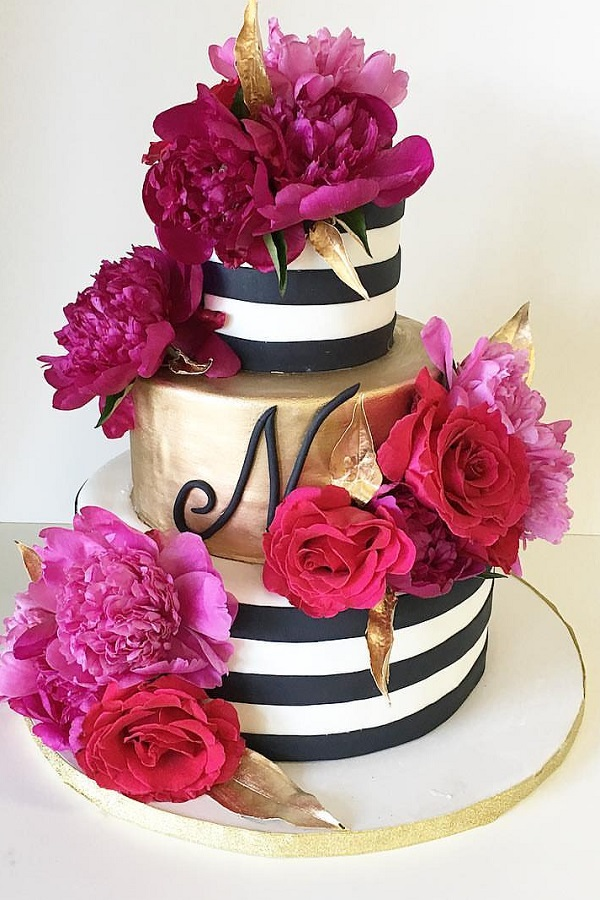 gold and floral event cake