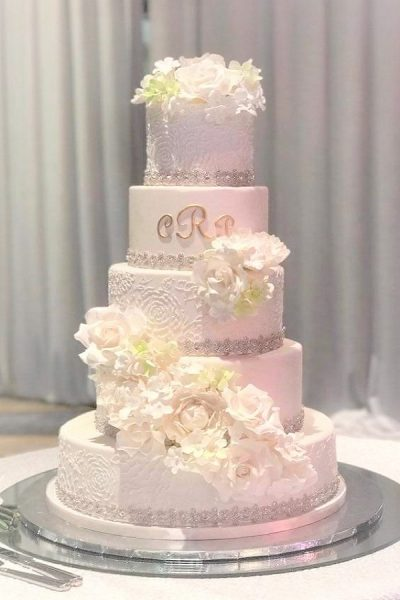 white piped wedding cake
